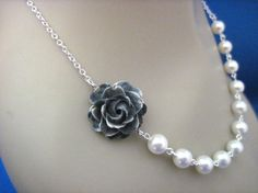 $20- Black and white rustic looking rose