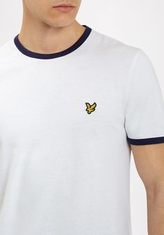 With a sleek navy trim set on a white tee, we present this super soft cotton top crafted by Lyle & Scott. Lyle Scott, White Tees, Get The Look, Polo Ralph Lauren, Mens Tops, Cotton, T Shirt, Outfits, Shopping