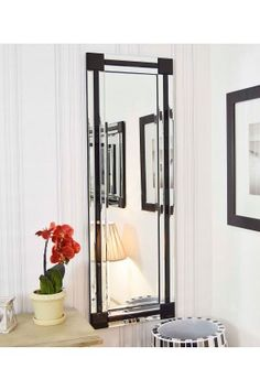 Black and silver, triple bevelled edge, Venetian mirror, with black block corners, will add style and character to any room from the living room to the bedroom, and will even make a chic bathroom mirror. With a triple black/silver outline and bevelled glass, this mirror brings any room alive with its modern design and will be a real focal point for your home.