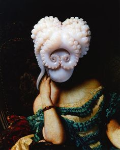 Grotesque yet utterly intriguing, Japanese photographer Yumiko Utsu's work enthralls the viewer with playful constructions of fruit, dismembered sea creatures, vegetables and insects set against colorful tapestries. Her bizarre and humourous photo-art, revolving around food and animals, falls into