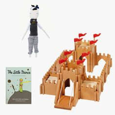 Jess Brown Max doll, $198, jessbrowndesign.com; Wooden castle, $350, normanandjules.com; The Little Prince Deluxe Pop-Up Book by Antoine de Saint-Exupéry, $35, themorgan.org