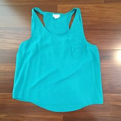 Teal Tank Top Bright, summery tank top by Saint & Noble. Runs a little short. Cute with high waisted shorts or a skirt. Worn a few times. Saint & Noble Tops Tank Tops