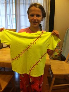 Softball shirt DIY at home, Liberty 11 did on her own using yellow shirt and red fabric paint.  She added her last name on the back.
