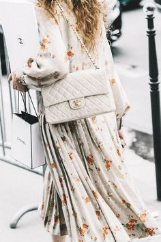 Floral dress and Chanel bag