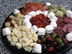 Our custom-made tray of olives, cheeses, and charcuteries - mouth watering goodness Party Platters, Food Platters, Office Catering, Cold Cuts, Specialty Foods, First Bite, For Your Party, Antipasto, Creative Food