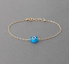 Turquoise Evil Eye Bracelet available in gold and by jennijewel, $21.00