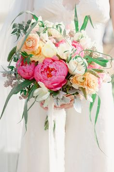Gorgeous Wedding Bouquet || A couple of peonies + SO much more! On Style Me Pretty:  http://www.StyleMePretty.com/tri-state-weddings/2014/02/14/valentines-day-volkswagen-photo-booth-bus-shoot/ Photography: Maggie Conley