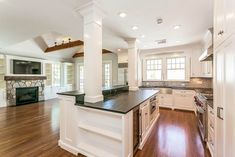 Home Improvement Archives Traditional Kitchen with Kitchen island, Farmhouse Sink, Ceramic Tile, Exposed beam, Inset cabinets Kitchen Island Ideas With Columns, Kitchen Columns, L Shaped Kitchen, Open Kitchen, Exposed Beams, Cuisines Design, Cool Kitchens, Tuscan Kitchens, Luxury Kitchens