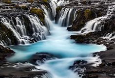 Ian Plant Dreamscapes Glacial-blue water cascades down a series of falls, Brúarfoss, Iceland.