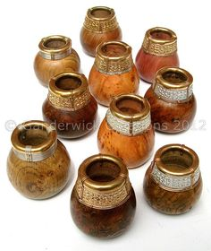 Most medieval people drank from simple beakers of wood or ceramic. Modern drinking beakers based on those found in the century Chieftain's grave at Sutton Hoo, England. Wood burl bodies with silver rims.