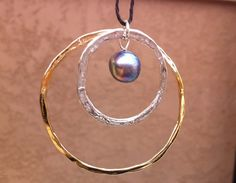 Circle circle pearl! - Gold vermeil and sterling silver with freshwater black pearl on cord...so nice.