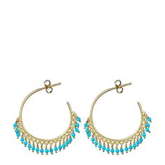 """Elegant and colorful, these recycled 18K gold hoops feature hand beaded sleeping beauty turquoise beads. A perfect accessory for day or night, these earrings hang 1 1/4"""" in diameter from 18K gold ear"""