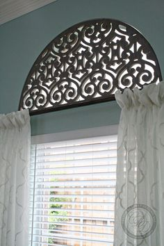 Installed a custom Tableaux design in this formal dining room arch window with soft, sheer, embroidered drapery.