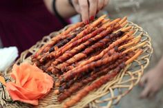 Bacon Straws Ingredients: •1 pound bacon, • 1 package crisp bread sticks, • Brown sugar, • Cayenne pepper Cut bacon in half , take one piece and wrap completely around a bread stick in a tight spiral. Place them on a baking sheet covered in tin foil. Sprinkle with brown sugar and cayenne pepper. Cook at 350 for 10 to 15 minutes. Drain grease. Cook for 5 or 10 more minutes until bacon becomes crisp. Cool on wax paper.