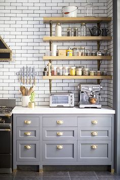 Having a Moment: Blue-Gray Kitchen Cabinets // subway tile, open shelving, espresso machine, brass handles