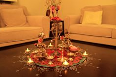 Diwali Lamp Centerpiece.. petals and alpana doilies replace flower arrangements