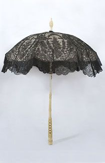 Chantilly lace parasol with carved ivory handle, 1860s. The aristocratic,  diminutive parasol features fine Chantilly lace, an intricately hand carved handle, and an unusual combination of two silk linings. The top lining layer, under the lace, is ivory silk taffeta. The under layer is a delightful (and surprising) pink hue. (top)