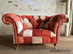 Modern British Handmade Patchwork Chesterfield Snuggle Chair. Totally Unique Fabric 3 Seater, Shown in a Warm Terracotta Tones. | Abode Sofas