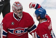 Montreal Canadiens goalie Carey Price, left, and P.A. Parenteau celebrate their victory over the Ottawa Senators in the NHL Stanley Cup first round playoff hockey action Wednesday, April 15, 2015 in Montreal. The Canadiens beat the Senators 4-3 to take a 1-0 lead in the best of seven series. (Paul Chiasson/The Canadian Press via AP) MANDATORY CREDIT