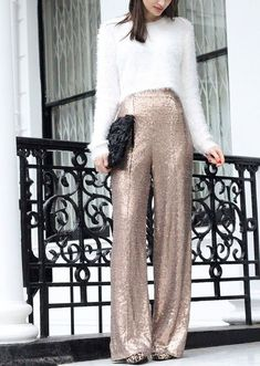 What a gorgeous and totally glamorous take on a New Years Eve outfit for women. You'll have all eyes on you with this outfit! I'd pair it with some statement earrings and maybe a fun cocktail ring. #NewYearsEve #NYE #NewYears #NewYearsEveoutfit #womensfashion #holidayoutfit #holidayattire #NYEoutfit #styleinspo #ootd #holidayootd #glittery #sparkly