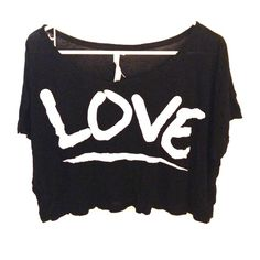 """Black Crop Top with White Lettering. Size XL Black crop top with the word """"LOVE"""" written across and underlined in white. Size extra large. Manufactured by a company called EXIST. It was made in China. The fabric is 60% cotton, 40% polyester. Crop top is meant to be loose and not form fitting. Shirt has never been worn, but has no tags. EXIST Tops Crop Tops"""