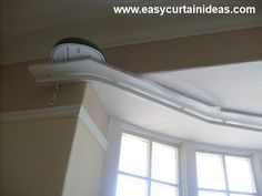 curved curtain rods, bay window treatment ideas, window treatment for bay window
