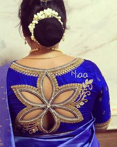 Silk saree blouse designs featuring floral cut out design on the back. pattu saree blouse designs with cut work Indian Blouse Designs, Blouse Back Neck Designs, Saree Jacket Designs, Pattu Saree Blouse Designs, Silk Saree Blouse Designs, Fancy Blouse Designs, Bridal Blouse Designs, Blouse Patterns, Sewing Patterns