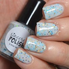 The 5th and final polish in the new Spring into Wonderland Collection by @sincerelypolish Is 'Adorably Alice', inspired by Alice in Wonderland. This perfect white crelly has blue, gold, and black glitters, with a hint of holo. I'm wearing three easy-to-apply coats and top coat. Collection releases 3/19 10:00 a.m. PST! Follow Karen for updates @sincerelypolish!  #SincerelyPolish #Rikkis_nails_