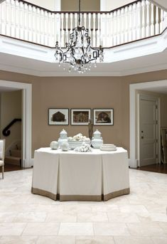 Designer Mary Douglas Drysdale grounded this three-story octagonal #foyer with a muted color scheme. #interior #design