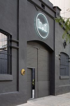 http://freshome.com/2012/01/23/former-industrial-warehouse-turned-into-design-gallery-in-barcelona/