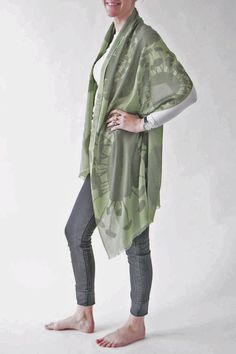 """Abstract Blooms appear on this 100% merino wool scarf (80"""" L x 28"""" W). This soft-to-the-touch scarf in leafy shades of green is seasonless and is perfect for cool summer evenings or to add warmth and a spot of color and design during the colder months. Bloom Green Scarf by Pilgrim Waters. Accessories - Scarves & Wraps Cape Cod Massachusetts"""
