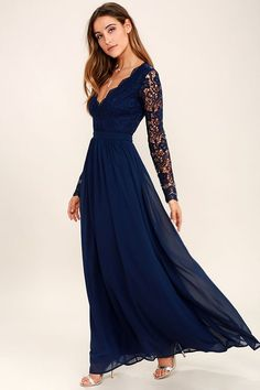 Open your eyes to a world of beautiful possibilities in the Awaken My Love Navy Blue Long Sleeve Lace Maxi Dress! Crocheted lace elegantly graces the fitted bodice of this stunning dress, a with V-neckline and sheer long sleeves. An open back and banded, fitted waist sit above a romantic full length skirt. Hidden back zipper with clasp.