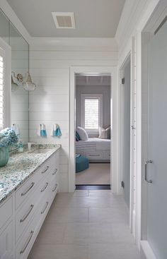 Same house, different view: from bunk room to guest bathroom. So coastal + lovely. Sea glass-like counter.