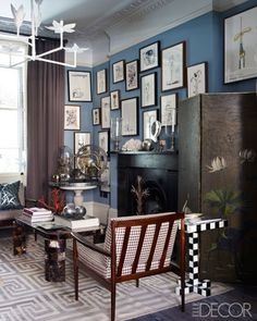 Coral accents, hand painted screens, greek key carpet. A total mishmosh of print, style, period and color. I adore it. Fashion Editor Kim Hersov's London Home - ELLE DECOR