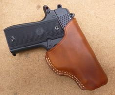 Clean, simple custom made leather open top belt carry holster for Colt Mustang. Hand-made to order in a range of 18 colour shades from makeitjones.co.uk