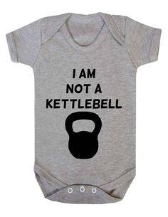 Baby Bodysuit Babygrow I Am Not A Kettlebell by JustAnotherTeeUK