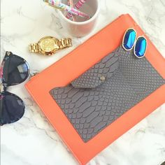 """Zara Python-Embossed Clutch Coral & Gray Color  *  Grained faux-leather (polyurethane) clutch bag. * Silvertone hardware and tonal topstitching. * Top zip closure. * Front python-embossed slip pocket with removable flap-top pouch. * Fabric lining. * 7.5""""H x 10""""W x 0.5""""D; weighs 6.6oz. * """"Zara"""" is imported. Bags Clutches & Wristlets"""