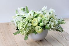 The whites of spring are fresh and softened: 'Cream Classic' by Winston Flowers.