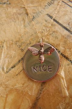 Necklace Hand Stamped Metal Copper BEE NICE Charm. $24.00, via Etsy. stamped metal blanks: http://www.ecrafty.com/casearch.aspx?SearchTerm=stamping+blank
