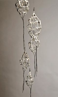"Ceramics by Lesley Risby at Studiopottery.co.uk - 2010. ""Hanging fragments"" - length 1.5m. Photography is by Sussie Ahlburg"