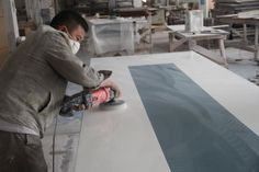 Polishing. Conference table with solid surface and stainless steel table base - TW-MATB-021 - Tell World Solid Surface