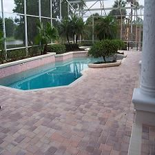 finished pool deck with 30mm overlay pavers waiting for cleaning