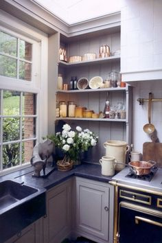 Open shelving, grey cabinets. Very pretty!