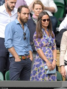 Pippa held a baby blue clutch as her and brother James watched proceedings on her fourth v...