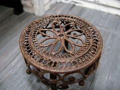 old rusty metal footstool