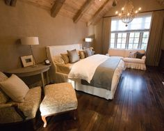Beautiful bedroom with dark stained Hickory hardwood floors.