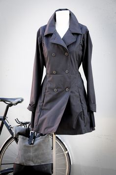 dear Lord - it's perfection. Spendy, spendy perfection. women's riding coat. Designed for your whole day. From the bike commute, to lunch out with colleagues, to a glass of wine with friends before heading home.  Designed for Seattle. For the wet weather and short days of our winters, and for our rather hilly journeys to work.