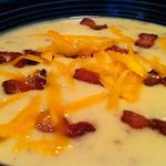 Potato Soup - crockpot style.  Creamy soup made in the crockpot, with just a few ingredients!  Come home to some comfort!