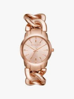 This rose gold-tone watch boasts a twist on a classic design while pavé crystals accent the face with subtle sparkle. The braided band looks chic paired with delicate bangles or worn solo as a statement piece.
