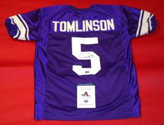 """$199.44 Autographed LaDainian Tomlinson Authentic Style Custom TCU Horned Frogs Jersey. LaDainian inscribed """"5"""" for his jersey number. Ready to be displayed in your sports room! It comes with either AAA Authentication tamper proof serial numbered hologram sticker and matching hologram COA card OR LT's own LaDainian Tomlinson hologram sticker. LT is one of the greatest Running Backs in the history of the game! This is an absolute must for all football fans!"""